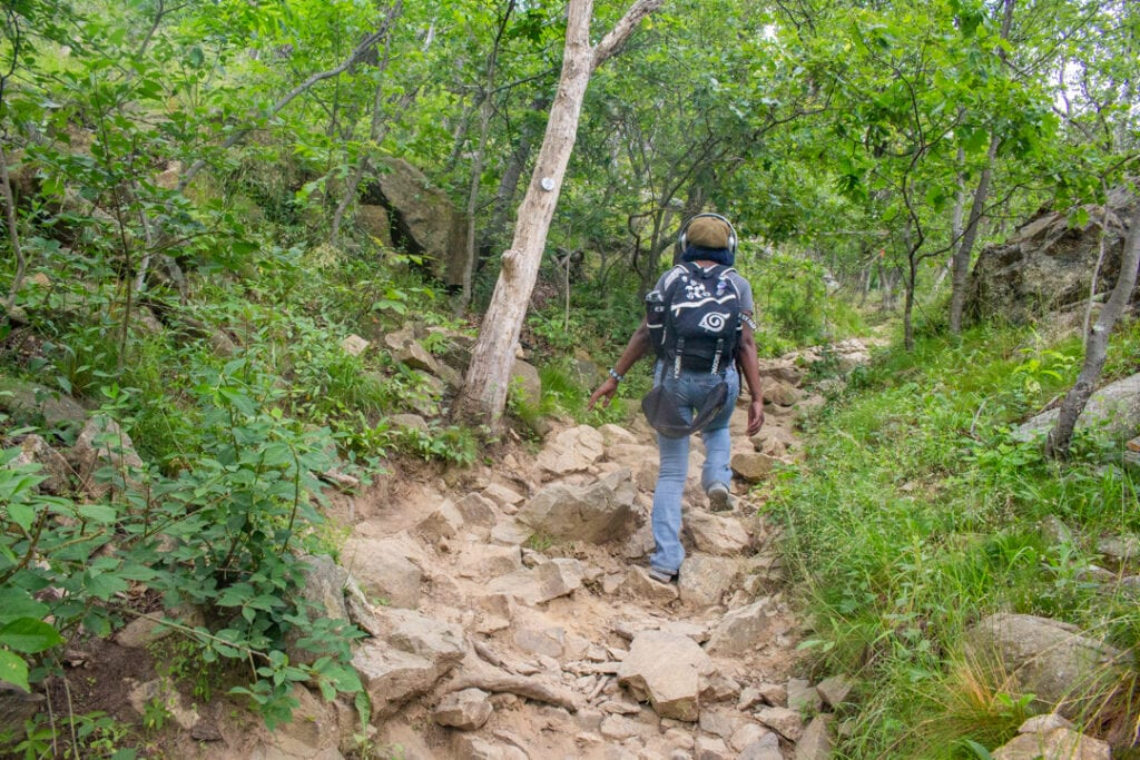 nature photography hiking up a rocky trail